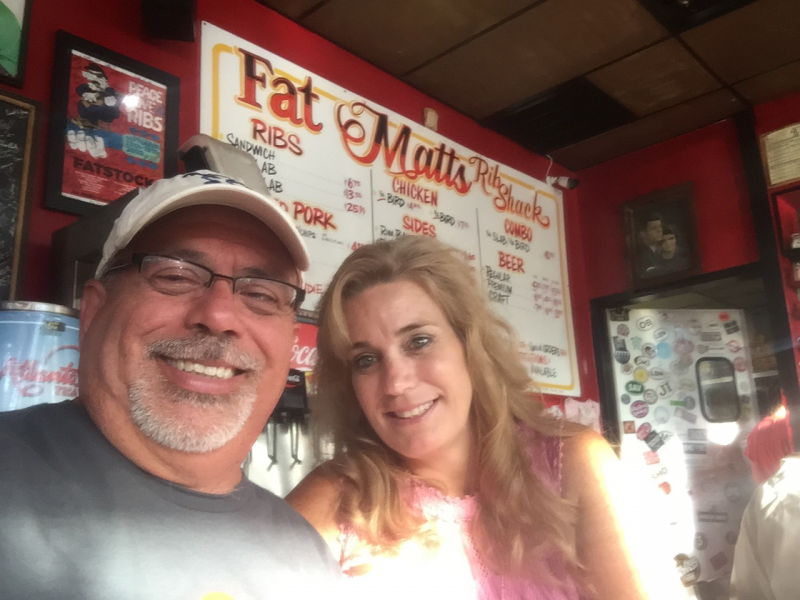 Wendy and Victor with other Rotarians having excellent BBQ at Fat Matt's in Atlanta